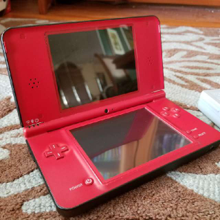 Nintendo DSi XL Red Super Mario Bros 25th Anniversary